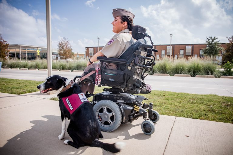 A student on campus with their service animal.