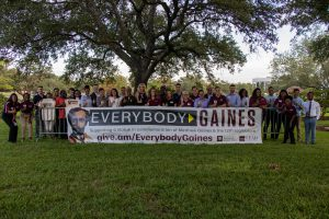 "Group image of diverse group of students holding a ""Everybody Gaines"" sign."