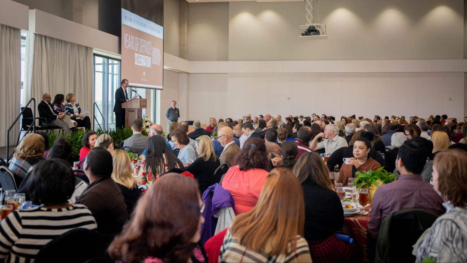 Wide angle shot of Mr. Tom Reber speaking at the Years of Service Celebration