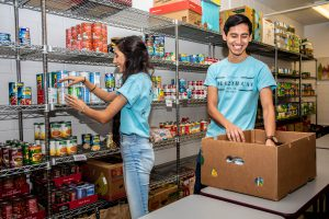 Image of students stocking the pantry for the 12th Can