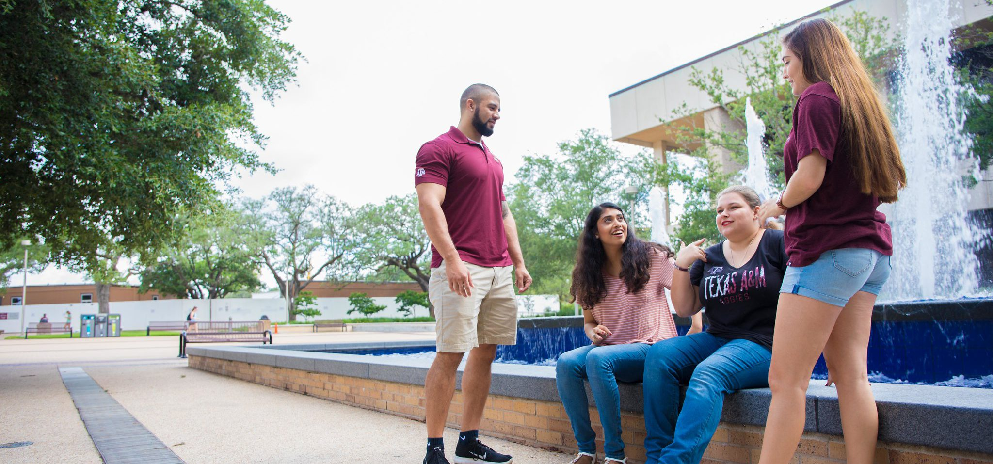 Stock Image of 4 students in front of Rudder Fountain.