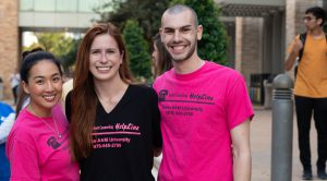 3 students with HelpLine t-shirts