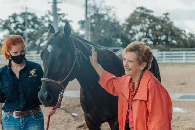 Image of Dorothy McFerrin and Corps of Cadets staff member with sponsored horse Artie