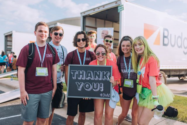 """Image of a group of students at Fish Camp holding up a chalkboard sign that says """"Thank you #stuact"""""""